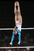 Sept 8, 2007; Stuttgart, Germany; Ksenia Semenova of Russia recatches on uneven bars to help Russia place fourth in women's artistic gymnastics team competition at 2007 World Championships. Photo by Tom Theobald. Copyright 2007 by Tom Theobald