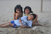 Children in the small seaside fishing village of Puerto Lopez, Ecuador