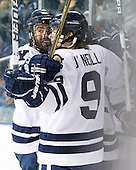 Ken Trentowski (Yale - 12), Brian O'Neill (Yale - 9) - The Yale University Bulldogs defeated the Air Force Academy Falcons 2-1 (OT) in their East Regional Semi-Final matchup on Friday, March 25, 2011, at Webster Bank Arena at Harbor Yard in Bridgeport, Connecticut.