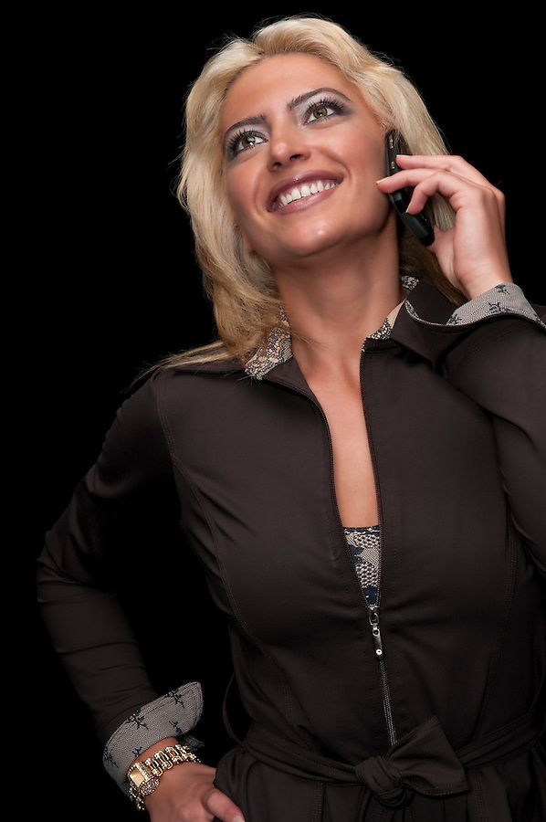 Happy businesswoman talking in the pda cell phone very happy.
