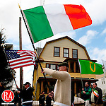 WATERBURY, CT, 05 MARCH 2011-030511JS03--Members of the Monsignor Slocum Division #1 Ancient Order of Hibernians carry national and county flags as they march in the annual Waterbury St. Patrick's Day Parade Saturday from Washington Park in Waterbury. Among those on hand for the event were Honorary Mayor for St. Patrick's Day Joseph Kelly and Parade Marshall Frank Linden. <br /> Jim Shannon/Republican-American