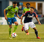 Seattle Sounders Lamar Neagle  (27) controls the ball against  New England Revolution Kevin Alston during an MLS match on March 8, 2015 in Seattle, Washington.  The Sounders beat the Revolution 3-0.  Jim Bryant Photo. ©2015. All Rights Reserved.