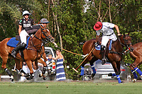 WELLINGTON, FL - APRIL 15:  Jared Zenni of Palm Beach Illustrated (dark jersey) and Gringo Colombres of Valiente battle for the ball as Tommy Collingwood looks on in the $100,000 World Cup Final, at the Grand Champions Polo Club, on April 15, 2017 in Wellington, Florida. (Photo by Liz Lamont/Eclipse Sportswire/Getty Images)