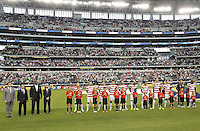 USMNT team and CONCACAF officials during the American national anthem prior to the match against Honduras on July 24, 2013 at Dallas Cowboys Stadium in Arlington, TX.
