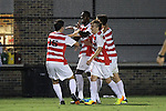 30 August 2013: Rutger's Kene Eze (2nd from left) celebrates his goal with teammates. The Duke University Blue Devils hosted the Rutgers University Scarlet Knights at Koskinen Stadium in Durham, NC in a 2013 NCAA Division I Men's Soccer match. The game ended in a 1-1 tie after two overtimes.