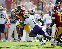 7 October 2006:  #8 Dashon Goldson tackles #26 Emmanuel Moody with the ball at a second down during NCAA College Football Pac-10 USC Trojans 26-6 win over the Washington Huskies at the LA Coliseum during a sunny saturday game in Los Angeles, CA.<br />
