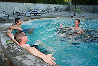 Kananaskis Country, Alberta, Canada, August 2008. Mountain bikers relax in the hot tub of the Kananaskis Lodge, after a ride over the unhardened mountains trails. The Kananaskis is a tranquil and green part of the Rocky Mountains. Away from the masses it offers many outdoor adventure possibilities. Photo by Frits Meyst/Adventure4ever.com