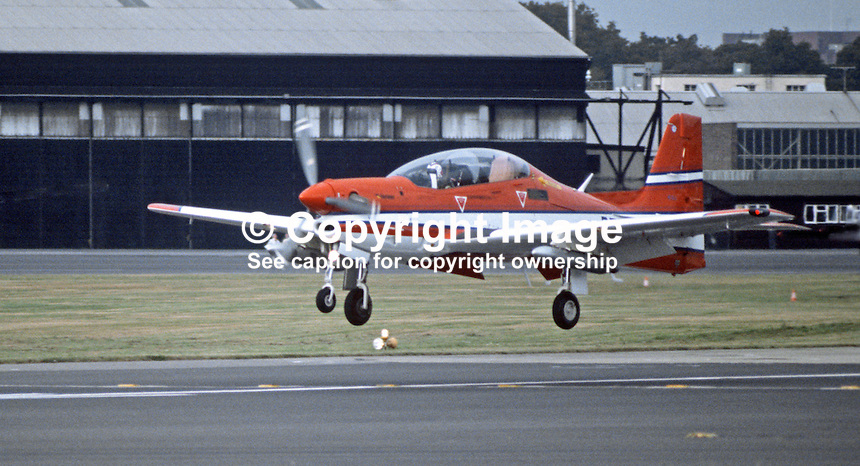 A prototype of the Shorts Tucano comes into land at the company's Belfast airfield after a demonstration flight. Derived from the outstanding Embraer Tucano EMB312, already in use with the Brazilian Air Force, it has been  modified by Shorts to meet the Royal Air Force's requirement for an advanced turboprop trainer. 3rd September 1984. 19840113TUC2.<br /> <br /> Copyright Image from Victor Patterson,<br /> 54 Dorchester Park, Belfast, UK, BT9 6RJ<br /> <br /> t1: +44 28 90661296<br /> t2: +44 28 90022446<br /> m: +44 7802 353836<br /> <br /> e1: victorpatterson@me.com<br /> e2: victorpatterson@gmail.com<br /> <br /> For my Terms and Conditions of Use go to<br /> www.victorpatterson.com