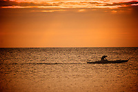 Fisherman in sunset