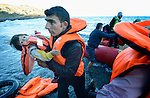 Refugees--including this man and his daughter--land on a beach near Molyvos, on the Greek island of Lesbos, on November 2, 2015. They were received by local and international volunteers, then proceeded on their way toward western Europe. The boat was provided by Turkish traffickers to whom the refugees paid huge sums to arrive in Greece.