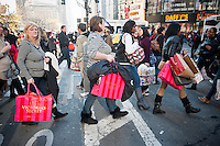 Shoppers in the Herald Square shopping district in New York looking for bargains on Black Friday, the day after Thanksgiving, Friday, November 25, 2011. Many retailers opened their doors on Thanksgiving or opened up for Black Friday the night before extending the shopping day into over 24 hours. (© Richard B. Levine)
