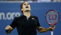Roger Federer of Switzerland celebrates after winning to Gael Monfils of France during their quarter-final game at the US Open 2014 tennis tournament at the USTA Billie Jean King National Center in New York.  09.04.2014. VIEWpress