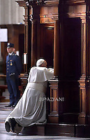 Pope Francis' receives confession during the penitential celebration in St. Peter's Basilica at the Vatican, March 13, 2015.