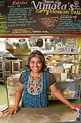 Executive Chef Vimala Rajendran behind the counter at the Curryblossom Cafe, voted Best New Restaurant, Waitstaff, Chef, and Outdoor Dining in the Triangle, Chapel Hill, N.C., Thursday, June 2, 2011.