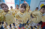 Children dance in a school in the Sabra refugee camp in Beirut, Lebanon, run by the Department of Service for Palestinian Refugees of the Middle East Council of Churches. Most of the school's 148 students are Syrian refugees, but roughly one-third are Palestinian refugees and a few are poor children from the neighborhood. Lebanon hosts some 1.5 million refugees from Syria, and yet the government prohibits the establishment of large refugee camps, thus pushing many refugee families to search for housing in existing Palestinian refugee camps. This school is supported by the ACT Alliance.