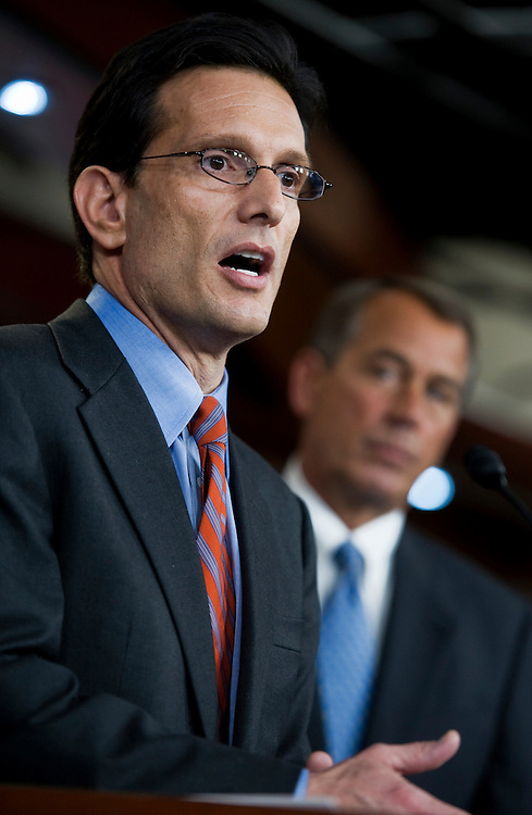 UNITED STATES - JANUARY 06:  House Majority Leader Eric Cantor, R-Va., left, and Speaker John Boehner, R-Ohio, conduct their first joint news conference in the Capitol after taking control of the House of Representatives on January 5th.  They addressed issues such as the national debt and their plan to repeal the health care reform law that was passed last year.  (Photo By Tom Williams/Roll Call)