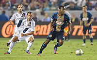 CARSON, CA - July 4, 2012: LA Galaxy midfielder Juninho (19) and Philadelphia Union defender Amobi Okugo (14) during the LA Galaxy vs Philadelphia Union match at the Home Depot Center in Carson, California. Final score LA Galaxy 1, Philadelphia Union 2.