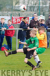 Over the top<br /> ----------------<br /> Limerick County U12 Cathel Kerins is put under pressure by Kerry's Alex Hoare when the played at Christy Leahy Park, Tralee last Sunday afternoon.