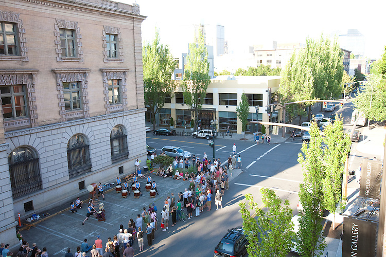 On the first Thursday of every month, art galleries in Portland hold receptions and stay open later in the evening to launch their new shows.  The galleries are primarily located in the Pearl District, but independent artists set up in the streets around the Pacific Northwest College of Art.