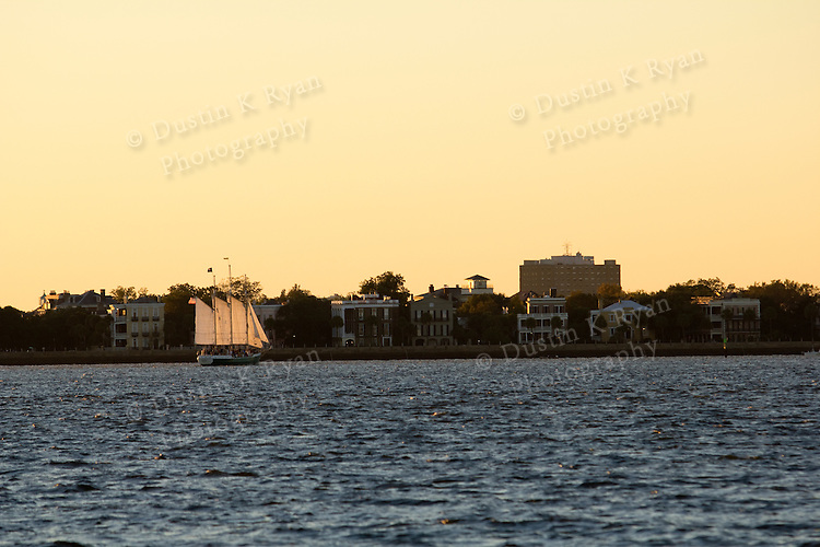 Schooner Pride Sailboat Sailing the Charleston Harbor during Sunset battery row
