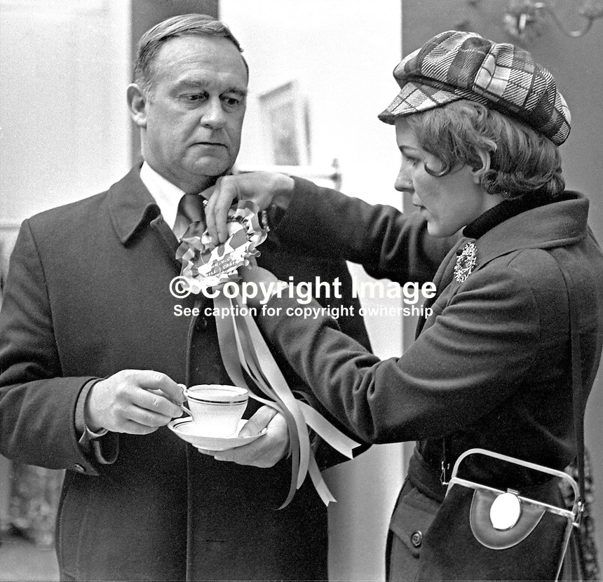 Vanguard Unionist politician, William Craig, at City Hall, Belfast, N Ireland, to hand in his nomination papers for the East Belfast seat in the 28th February 1974 UK General Election. His German-born wife, Doris, pins an election rosette on his lapel. 197402180130b<br /> <br /> Copyright Image from Victor Patterson,<br /> 54 Dorchester Park, Belfast, UK, BT9 6RJ<br /> <br /> t1: +44 28 90661296<br /> t2: +44 28 90022446<br /> m: +44 7802 353836<br /> <br /> e1: victorpatterson@me.com<br /> e2: victorpatterson@gmail.com<br /> <br /> For my Terms and Conditions of Use go to<br /> www.victorpatterson.com
