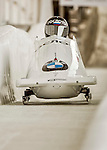 8 January 2016: Alexander Kasjanov, piloting his 2-man bobsled for Russia, enters the Chicane straightaway on his first run, ending the day with a combined 2-run time of 1:51.63 and earning a 13th place finish at the BMW IBSF World Cup Championships at the Olympic Sports Track in Lake Placid, New York, USA. Mandatory Credit: Ed Wolfstein Photo *** RAW (NEF) Image File Available ***