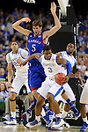 2 APR 2012: Forward Terrence Jones (3) from the University of Kentucky gains control of the ball in front of center Jeff Withey (5) from the University of Kansas during the Championship Game of the 2012 NCAA Men's Division I Basketball Championship Final Four held at the Mercedes-Benz Superdome hosted by Tulane University in New Orleans, LA. Kentucky defeated Kansas 67-59 to claim the championship title. Ryan McKeee/ NCAA Photos.