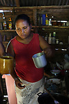 Mercedes Suárez Gálvez, from La Cerca, prepares coffee in her home. Barrick and Goldcorp's Pueblo Viejo open-pit gold mine threatens the cocoa-bean producing community of La Cerca. Cotuí, Sánchez Ramírez, Dominican Republic. April 2012.