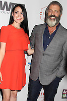 BEVERLY HILLS, CA - OCTOBER 21: Rosalind Ross, Mel Gibson at the World Poker Tournament's Four Kings And An Ace Charity Event at Citizen in Beverly Hills, California on October 21, 2016. Credit: David Edwards/MediaPunch