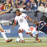 D.C. United defender Ethan White (15) works to clear ball. In a Major League Soccer (MLS) match, the New England Revolution (blue) defeated D.C. United (white), 2-1, at Gillette Stadium on September 21, 2013.