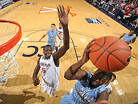 Jan. 8, 2011; Charlottesville, VA, USA;  North Carolina Tar Heels forward Harrison Barnes (40) shoots the ball in front of Virginia Cavaliers center Assane Sene (5) during the game at the John Paul Jones Arena. North Carolina won 62-56. Mandatory Credit: Andrew Shurtleff