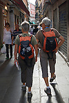 Venice Italy 2009. Older couple of tourists dressed in similar manner.
