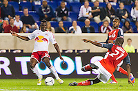 Aaron Maund (21) of Toronto FC goes for a tackle on Lloyd Sam (10) of the New York Red Bulls. The New York Red Bulls defeated Toronto FC 4-1 during a Major League Soccer (MLS) match at Red Bull Arena in Harrison, NJ, on September 29, 2012.