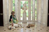 Patricia Kluge photographed with her dogs in the front foyer at her Albemarle Estate located in Albemarle County, Va. (Credit Image: © Andrew Shurtleff)..