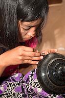 Myanmar, Burma. Bagan.  Lacquerware Workshop, Woman at Work.