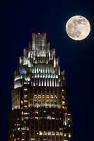 The full moon rising over the Bank of America tower in Uptown Charlotte, NC.