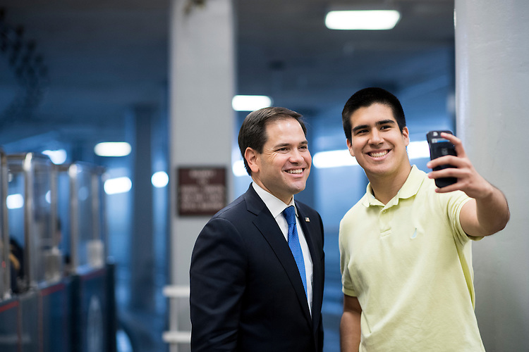 UNITED STATES - JUNE 29: Sen. Marco Rubio (R-FL) stops for a selfie with a man, who did not wish to give his name, in the Senate subway on Wednesday, June 29, 2016. (Photo By Bill Clark/CQ Roll Call)