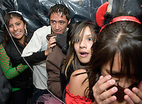 NEWS&GUIDE PHOTO / PRICE CHAMBERS.From left, Jennifer Garcia, Elvis Hurtado, Christian Espejel, Leslie Espejel and Yoseline Tzompa react to the horrific scenes inside the Haunted Maze on Halloween. The spooky labyrinth features terrifying appearances by a chainsaw wielding Jason, Freddy Kruger and others.