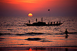 Fishermen set out at Sunset in Goa, India.