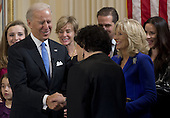 United States Vice President Joe Biden shakes hands with US Supreme Court Justice Sonia Sotomayor after taking the oath of office during the 57th Presidential Inauguration official swearing-in ceremony at the Naval Observatory on January 20, 2013 in Washington, DC. .Credit: Saul Loeb / Pool via CNP