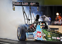 Sept. 17, 2010; Concord, NC, USA; NHRA top fuel dragster driver Terry McMillen does a burnout during qualifying for the O'Reilly Auto Parts NHRA Nationals at zMax Dragway. Mandatory Credit: Mark J. Rebilas/