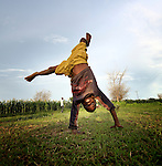 A boy does a cartwheel in Karonga, a town in northern Malawi.