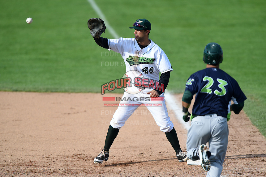 Jamestown Jammers first baseman Andrew Lambo (40), on rehab assignment, waits for a throw as Gabriel Santana (23) runs to first during a game against the Vermont Lake Monsters on July 13, 2014 at Russell Diethrick Park in Jamestown, New York.  Jamestown defeated Vermont 6-2.  (Mike Janes/Four Seam Images)