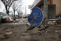 (March 31st, 2011)  Almost three weeks after the tsunami, the city of Sendai, with a population of over a million, struggles with the after effects.  Especially hard hit was the low-lying port area of Tagajo.  Here the wave was powerful enough to mow down street signs..