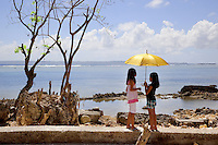 Philippines. Province Eastern Samar. Hernani. Two young girls with a yellow umbrella talk together on the dike protecting the town from the Philippines sea (Pacific ocean). On november 8 2013, 95 % of the town was destroyed by typhoon Haiyan's winds and storm surge. Typhoon Haiyan, known as Typhoon Yolanda in the Philippines, was an exceptionally powerful tropical cyclone that devastated the Philippines. Haiyan is also the strongest storm recorded at landfall in terms of wind speed. Typhoon Haiyan's casualties and destructions occured during a powerful storm surge, an offshore rise of water associated with a low pressure weather system. Storm surges are caused primarily by high winds pushing on the ocean's surface. The wind causes the water to pile up higher than the ordinary sea level. 26.11.13 © 2013 Didier Ruef