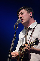 "Marcus Mumford strums the mandolin during a performance of ""Winter Winds"" at the Susquehanna Bank Center on February 16, 2013."