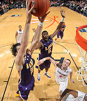 Jan. 2, 2011; Charlottesville, VA, USA; LSU Tigers forward Garrett Green (3) grabs the rebound in front of LSU Tigers forward Malcolm White (5) and Virginia Cavaliers forward Will Regan (4) during the game at the John Paul Jones Arena. Virginia won 64-50. Mandatory Credit: Andrew Shurtleff-