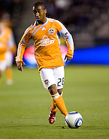 Houston Dynamo forward Corey Ashe (26) passes off a ball. The Houston Dynamo defeated CD Chivas USA 2-0 at Home Depot Center stadium in Carson, California on Saturday May 8, 2010.  .
