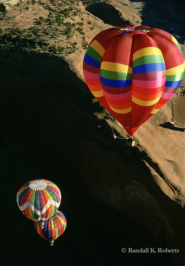 Hot air balloons glide above a canyon during the annual Red Rock Balloon Rally, Gallup, New Mexico