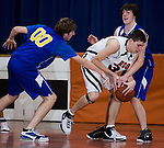PLYMOUTH, CT--03 January 08--010308TJ03 - Housatonic players Kyle Godburn (00), left, and Zach Williams (25) try to steal the ball from Terryville's Jason Pranulis during Terryville High School's 68-30 victory over Housatonic Valley Regional High School on Thursday, January 3, 2008. T.J. Kirkpatrick/Republican-American